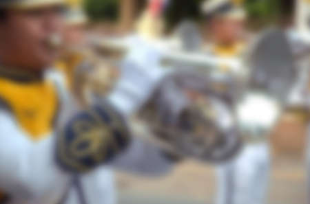 marching: blur photo background of marching band in parade