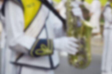 marching: blurred image marching band parade background