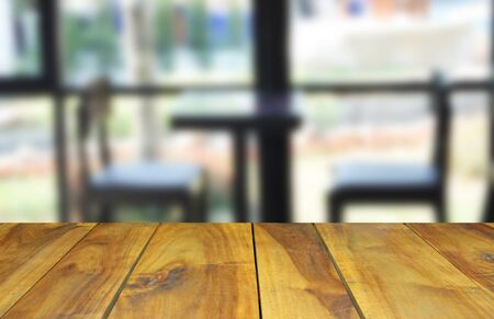 visitors area: blurred image wood table and abstract visitors chair in office