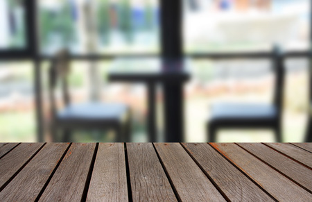 visitors: blurred image wood table and abstract visitors chair in office