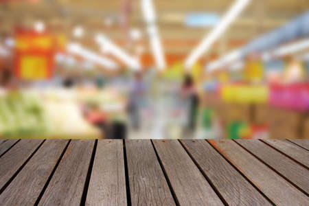 blurred people: blurred image wood table and abstract people shopping in supermarket
