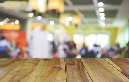 wood trade: blurred image wood table and abstract trade show and one stop shopping expo