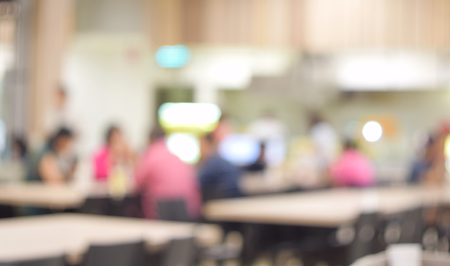 food shop: blurred photo of people in food center with light bokeh