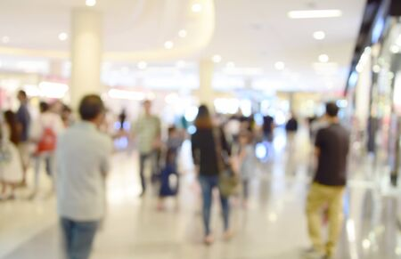 sidewalk sale: blurred image  people in shopping mall with bokeh Stock Photo
