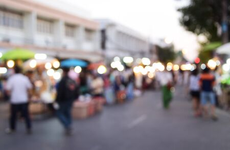 people: blurred image people walking street market
