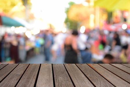 blurred image wood table and people walking street market Stock Photo