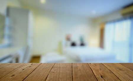 blurred image wood table and  bed room decoration