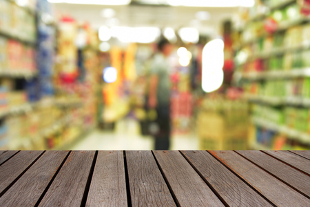 blurred image wood table and minimart convenience store Stock Photo