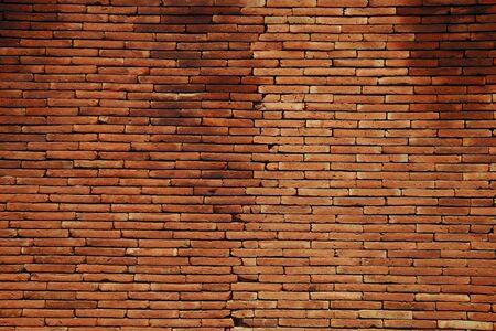 pendulum: red brick wall background