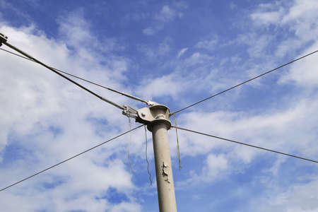 working stiff: sling metal pole on blue sky Stock Photo
