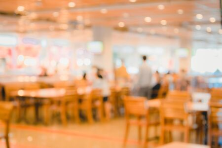 dining table and chairs: blur image of food court background