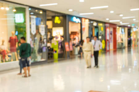 blurry image people man and woman waiking in shoppingmall Stockfoto