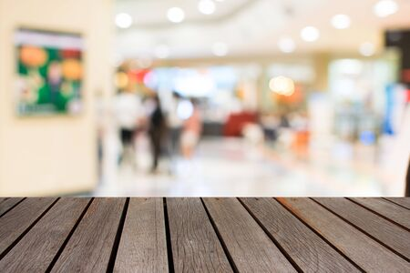 blurred image people in shopping mall with bokeh Stock Photo