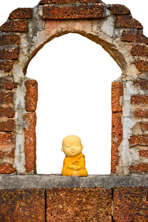 ceramic thai monk  sitting on the ancient wall photo