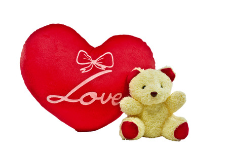 cream color bear and red heart pillow with love word on white  photo