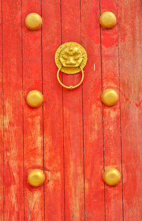 golden lion head on  old chinse traditonal door photo