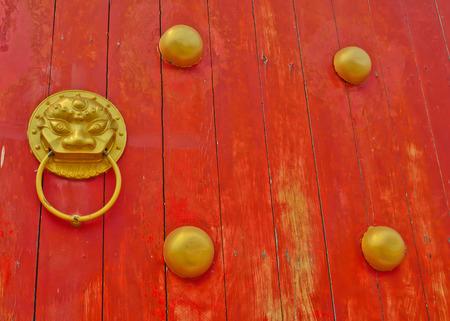 traditonal: golden lion head on  old chinse traditonal door