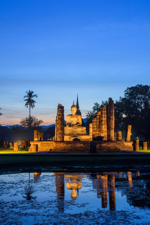 Mahathat temple in twilight time with blue sky background at Sukhothai Historical Park Thailand,famous tourist attraction in northern Thailand.Tourism industry concept.Traveling in Asia. Фото со стока