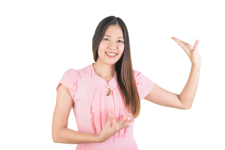 Happy smiling attrative asian young woman in pink dress performing typical thai dance.