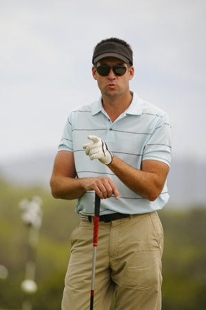 Golfer pointing his finger on the golf course Stock Photo