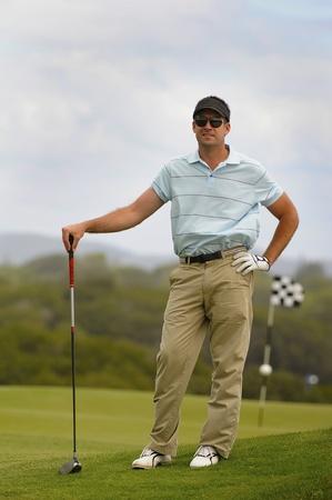 Golfer waiting on tee photo