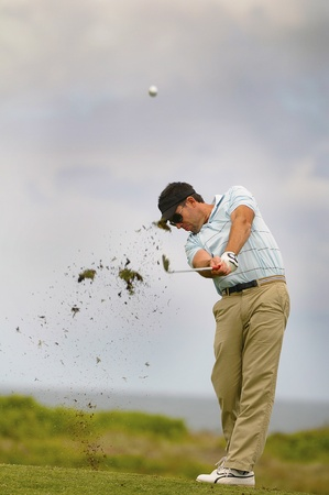 wedges: Golfer hitting the ball on the fairway