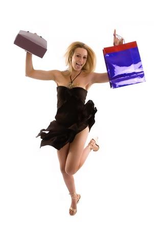 Excited shopper jumps after finding a bargin Standard-Bild