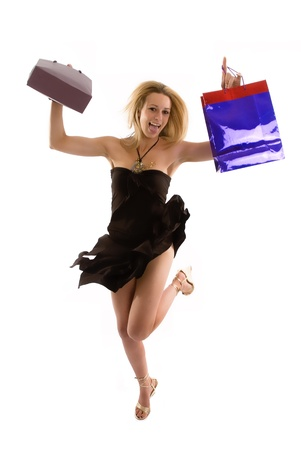 Excited shopper jumps after finding a bargin Stock Photo