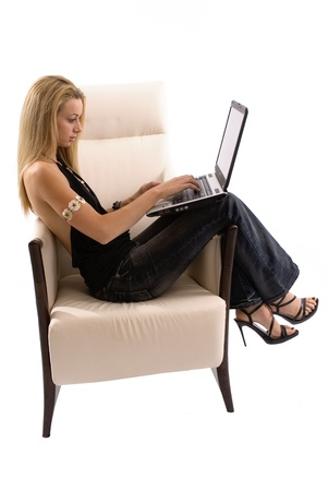 Working on the laptop in a comfortable chair