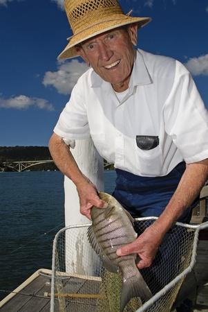 Old fisherman with blackfish