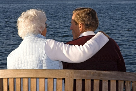 eternal life: Caring couple sitting and enjoying the sunset Stock Photo