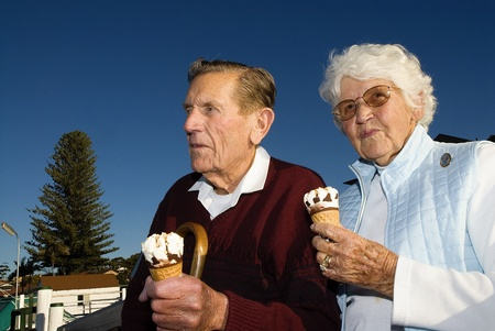 Couple eating an ice cream at the waterfront photo