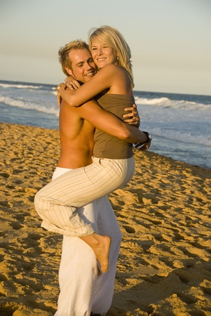 Embracing at the beach Stock Photo