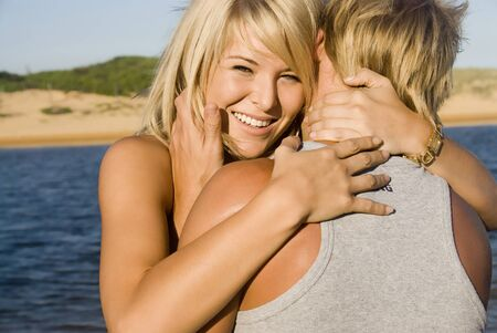 Happy young couple embrace at the beach Stock Photo
