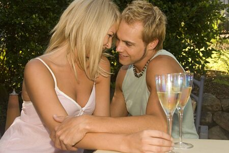 Attractive couple at garden cafe in love photo