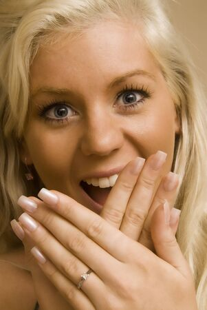 Suprised blond woman shows off her engagement ring Stock Photo - 9557071