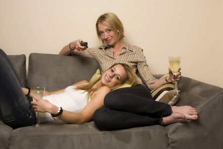 Friends watching TV, drinking wine