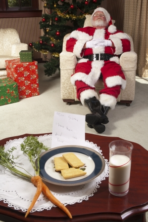 Santa takes a quick rest while delivering presents Stock Photo