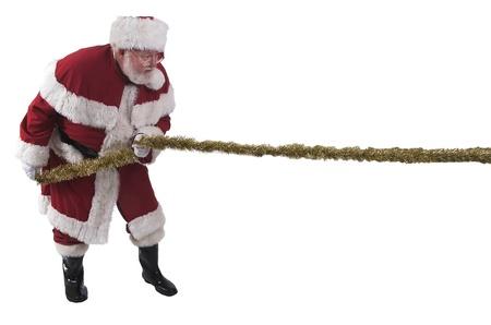 Santa in a Tug-o-war Stock Photo