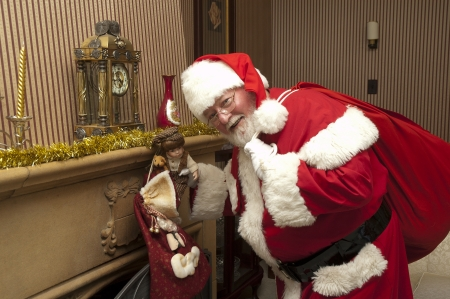 Santa leaving a gift in a stocking