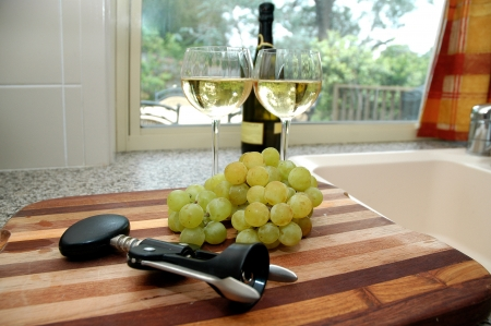 chopping: Wine and grapes Stock Photo