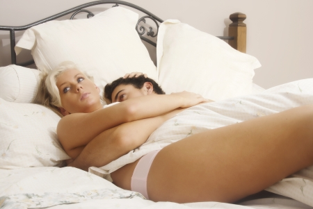 Young lovers in bed Stock Photo