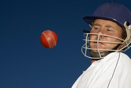 Cricketer evades a bouncer Stock Photo