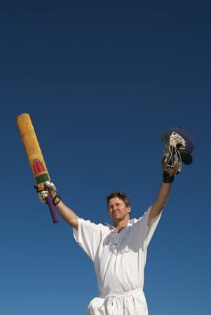 Cricketer celebrates 100  runs Stock Photo