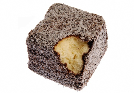 Fresh Lamington cake with a bite taken out Stock Photo