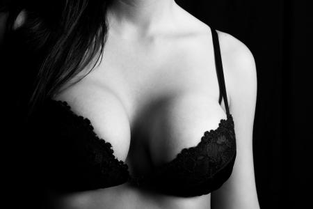 big boobs: Cerca de una mujer Foto de archivo
