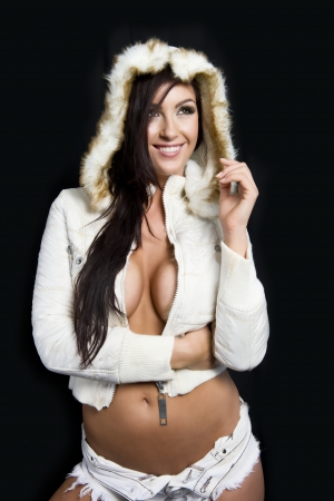 Attractive model poses with a white winter coat photo