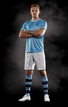Portrait of soccer player in studio 写真素材