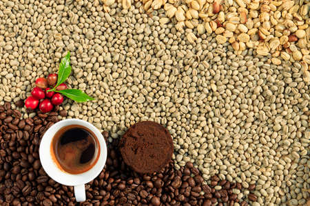 coffee grounds and coffee cup and red with green leaves coffee sherry and dried coffee beans processed backgrounds top view shot