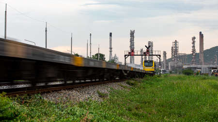 oil and gas refinery industry plant storage area with train moving foreground and evening in Thailand Stockfoto